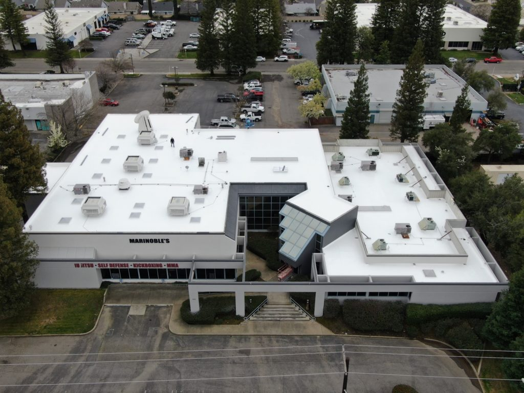 reroof of commercial building in sacramento flat roof pros
